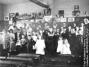 Photo of school classroom with students.
