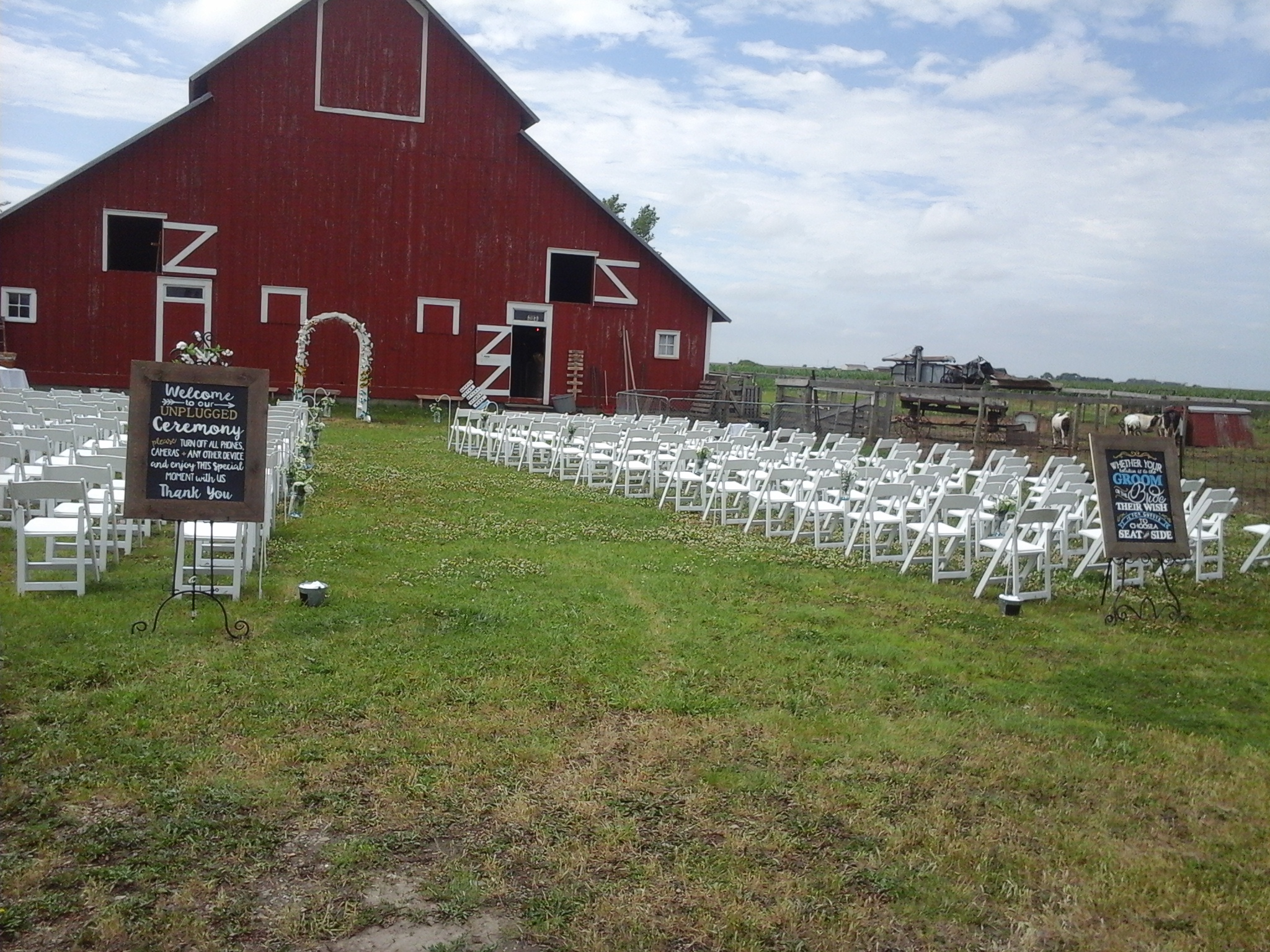 white chairs by barn